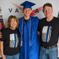 Vantage student graduate photographed with family.