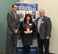 Mr. Unverferth, Mrs. Grothouse holding award, and OSBA representative standing