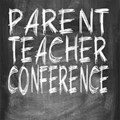 Chalkboard with Parent Teacher Conference written in white chalk