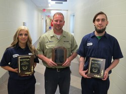 Welding students with awards