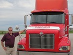 Truck Driving instructor next to red semi