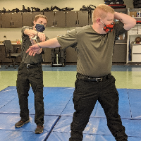 Police Academy students perform pat-down accuracy training.