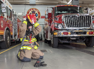 Firefighter Training program student goes through personal protective equipment training.