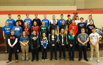 Winter athletics pose for picture