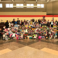Vantage Interact Club students raise money to purchase toys for the annual Toss A Toy campaign.