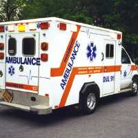 ambulance sitting in parking lot
