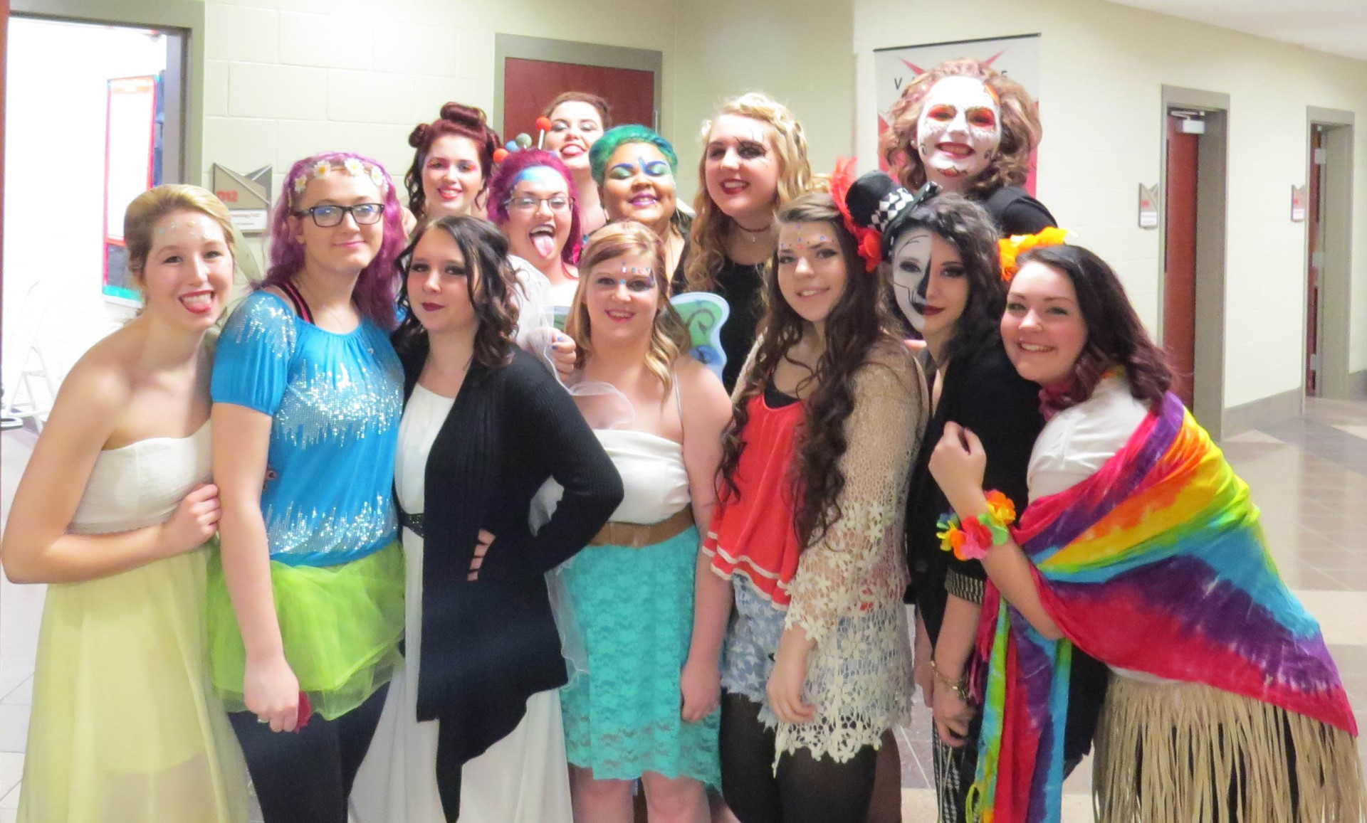 Female Cosmetology students dressed for Fashion Show