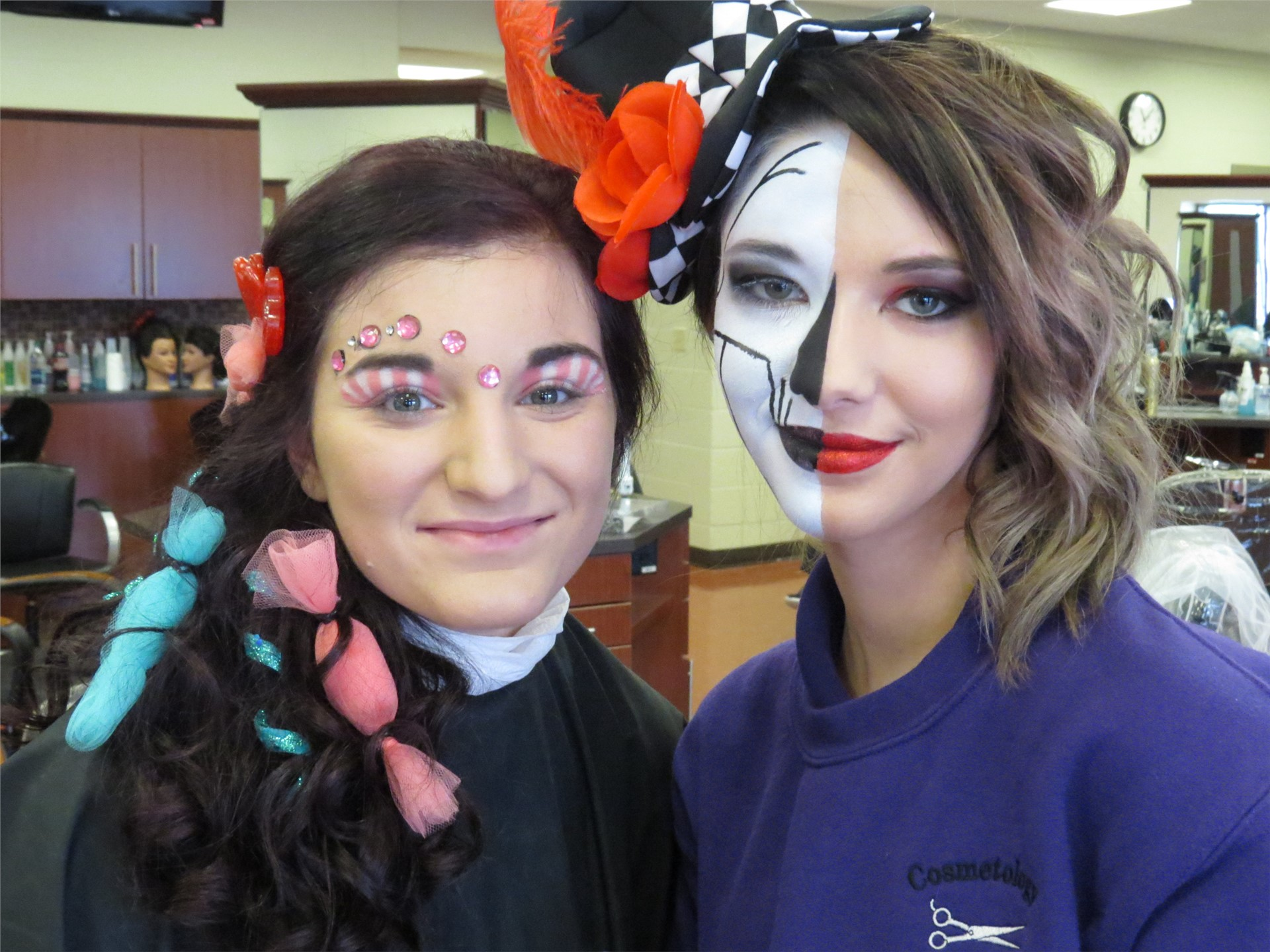 Two female Cosmetology students with theatrical make-up on