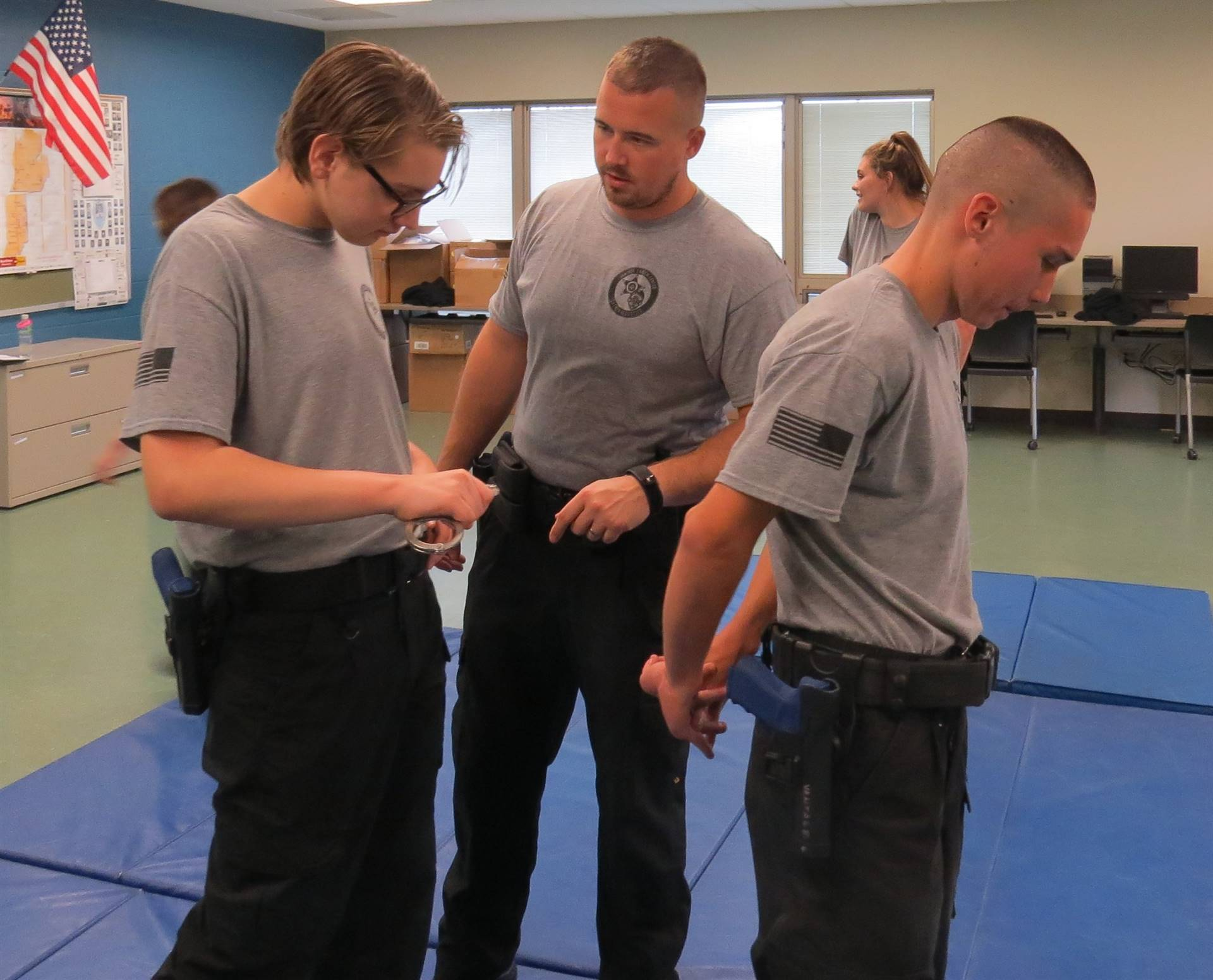 Criminal Justice female student practicing handcuffing skills