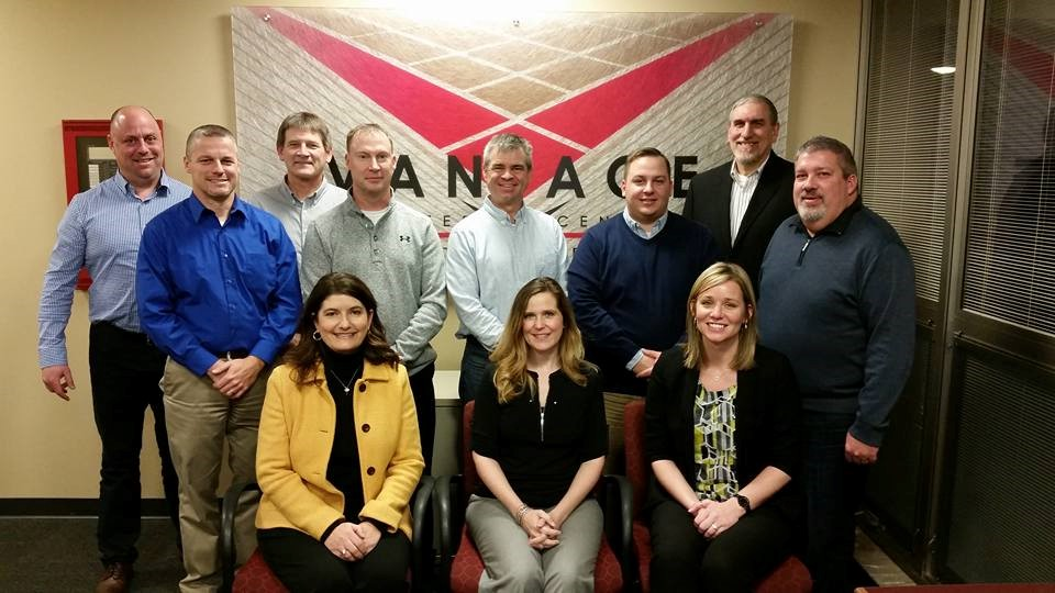 2017 Board of Education 8 males standing, 3 females sitting in front of Vantage logo sign