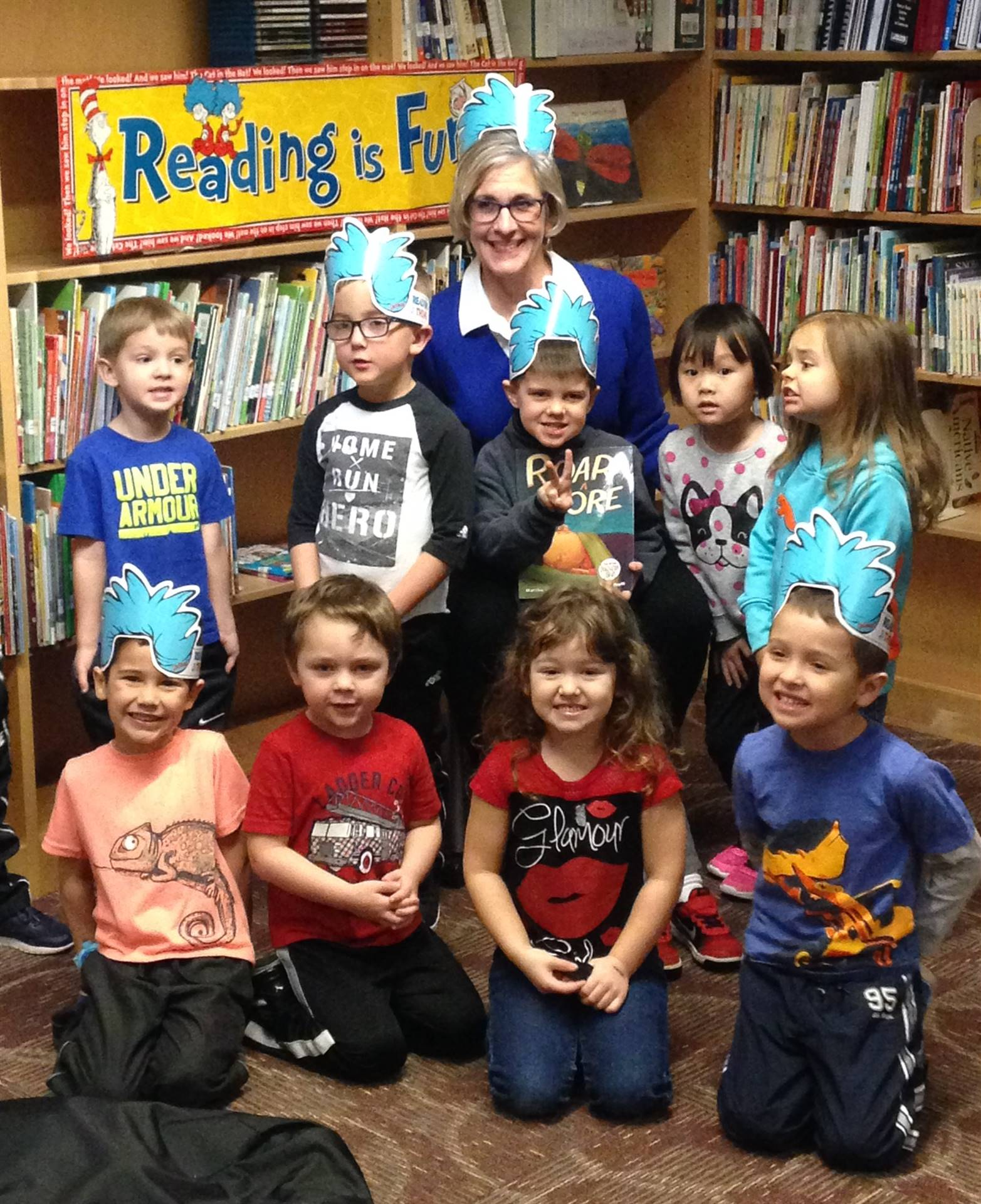 Preschoolers celebrating Read Across America with former superintendent Staci Kaufman