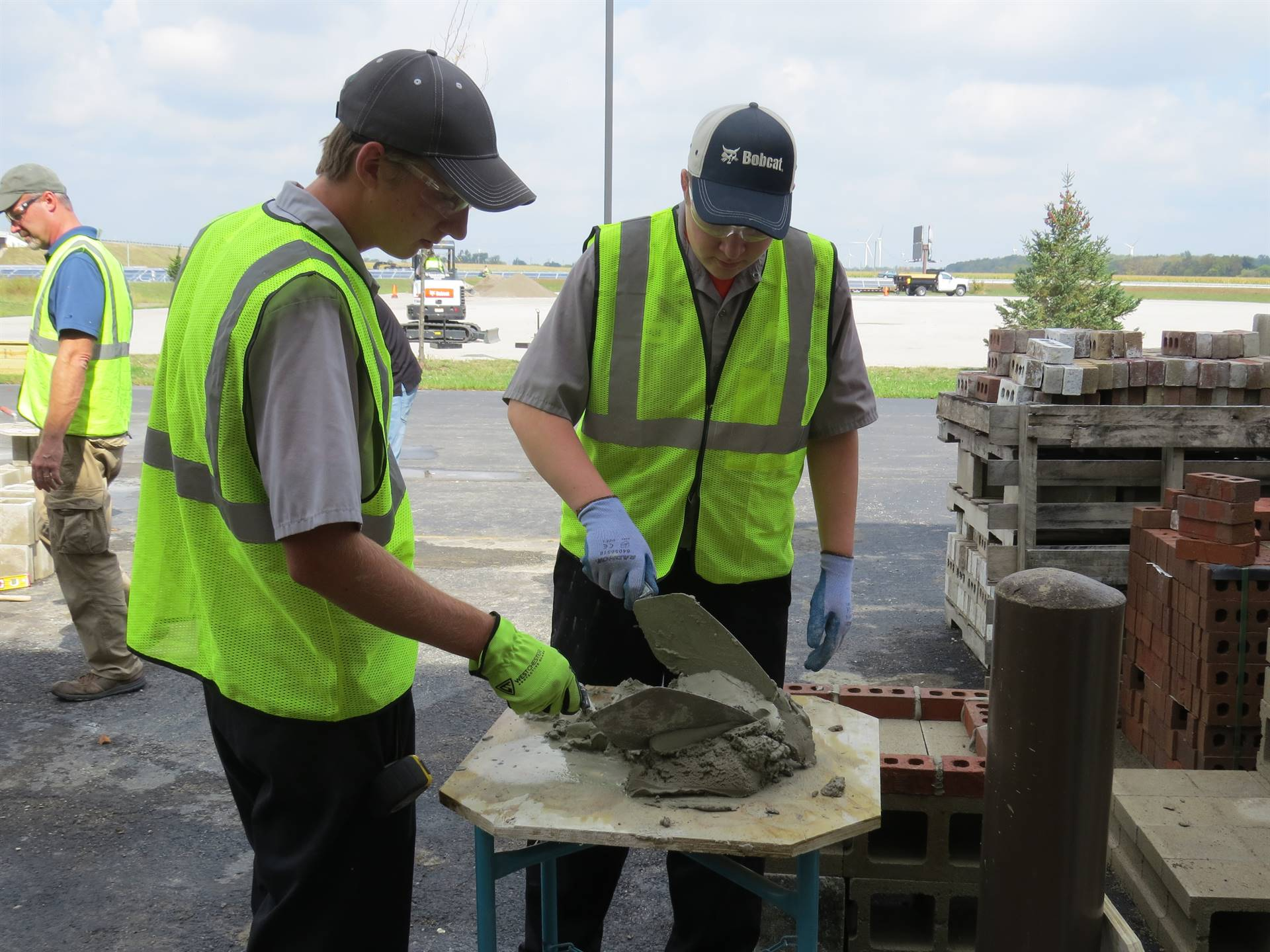 Two males students working with concrete