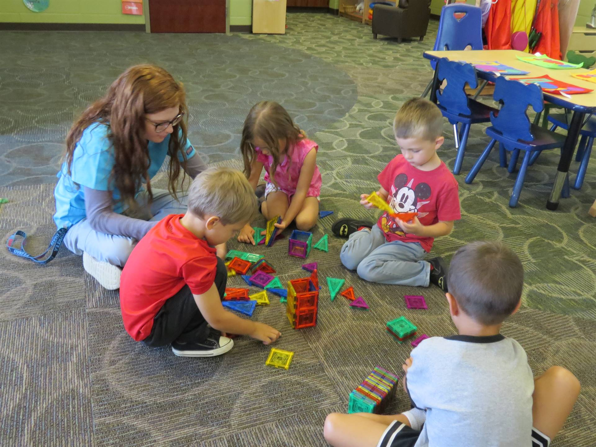 Preschoolers playing on the floor with blocks