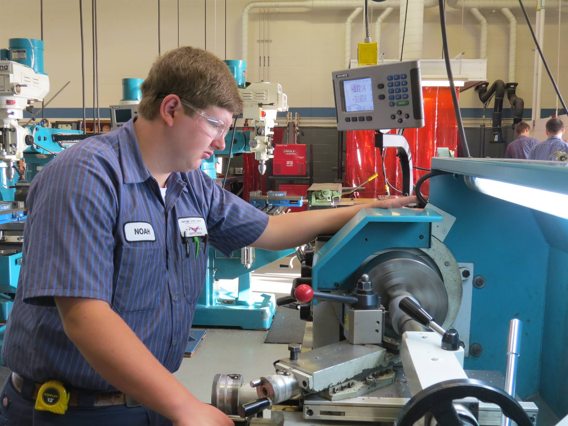 Male Industrial Mechanics student working on equipment