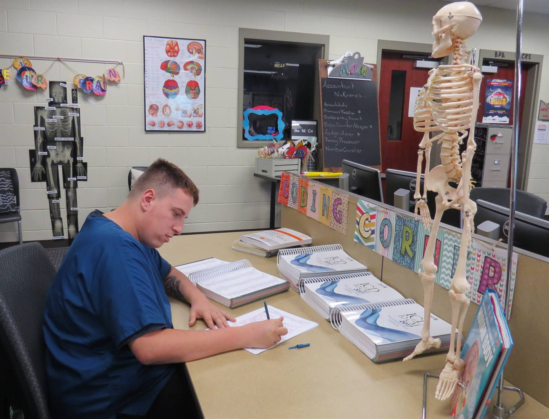 One male student working on medical billing and coding