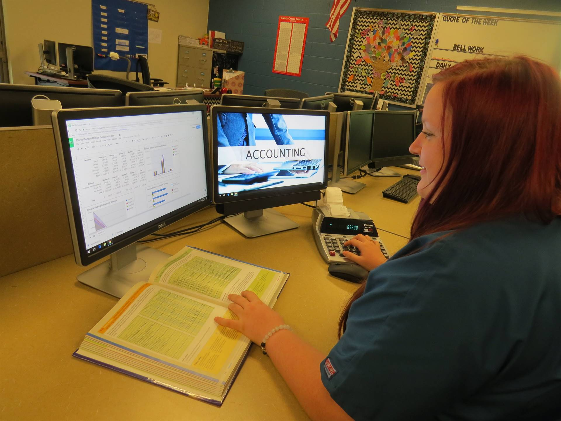 One female student working on accounting on the computer