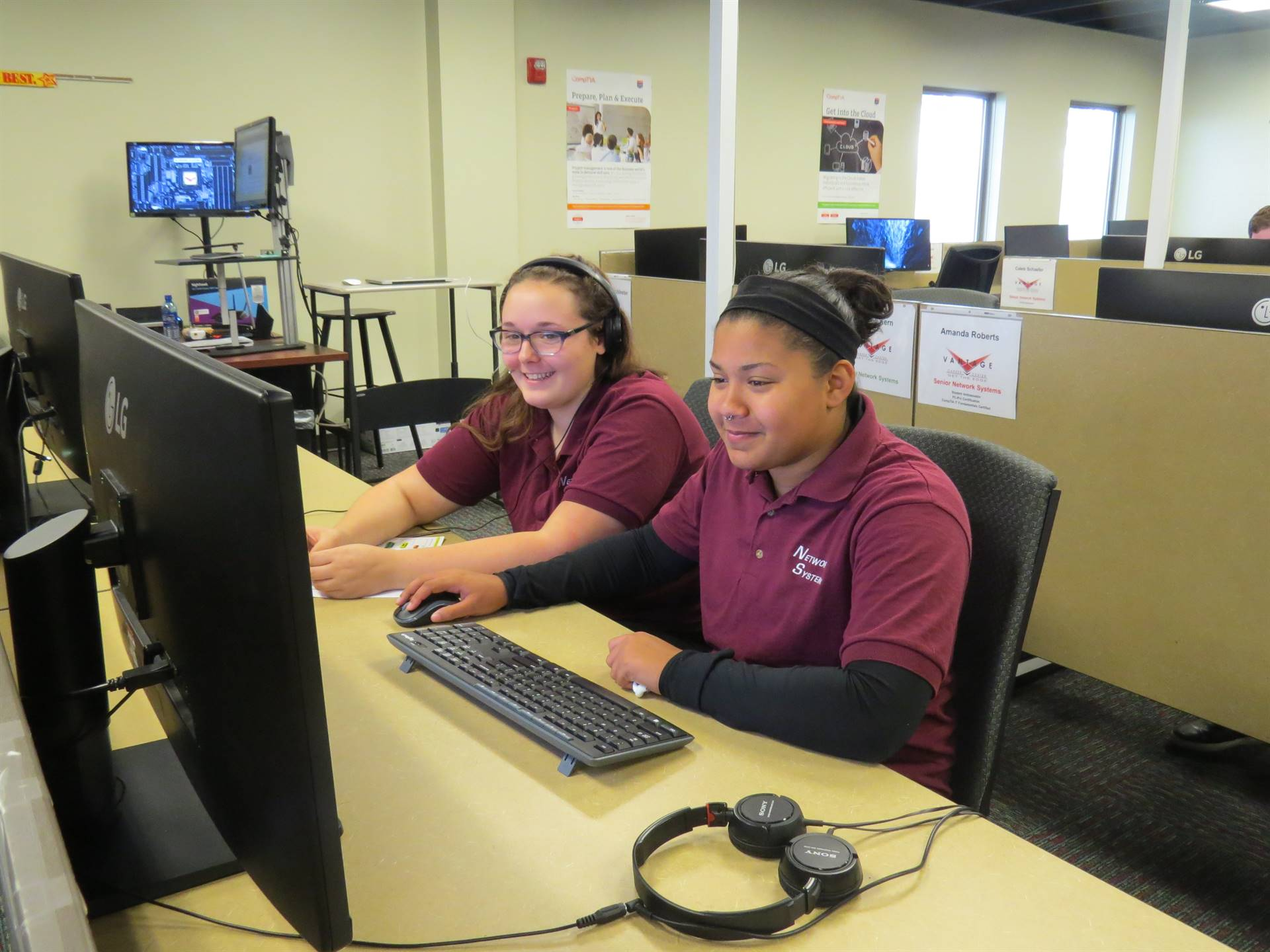 Two female students working on the computer together