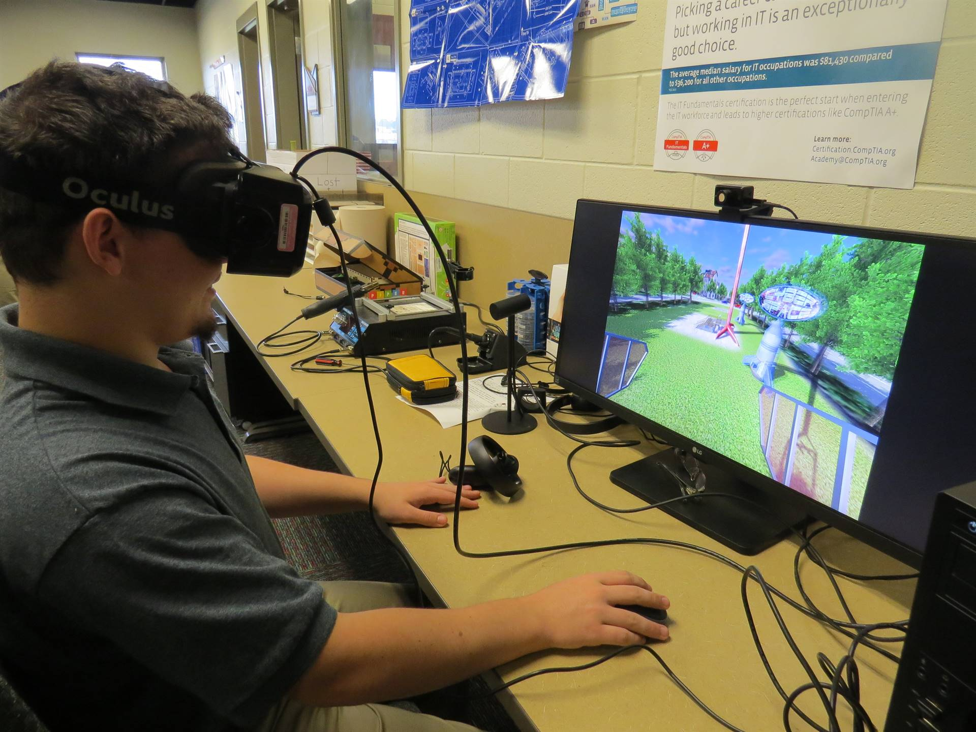 Male student working with virtual reality headset on