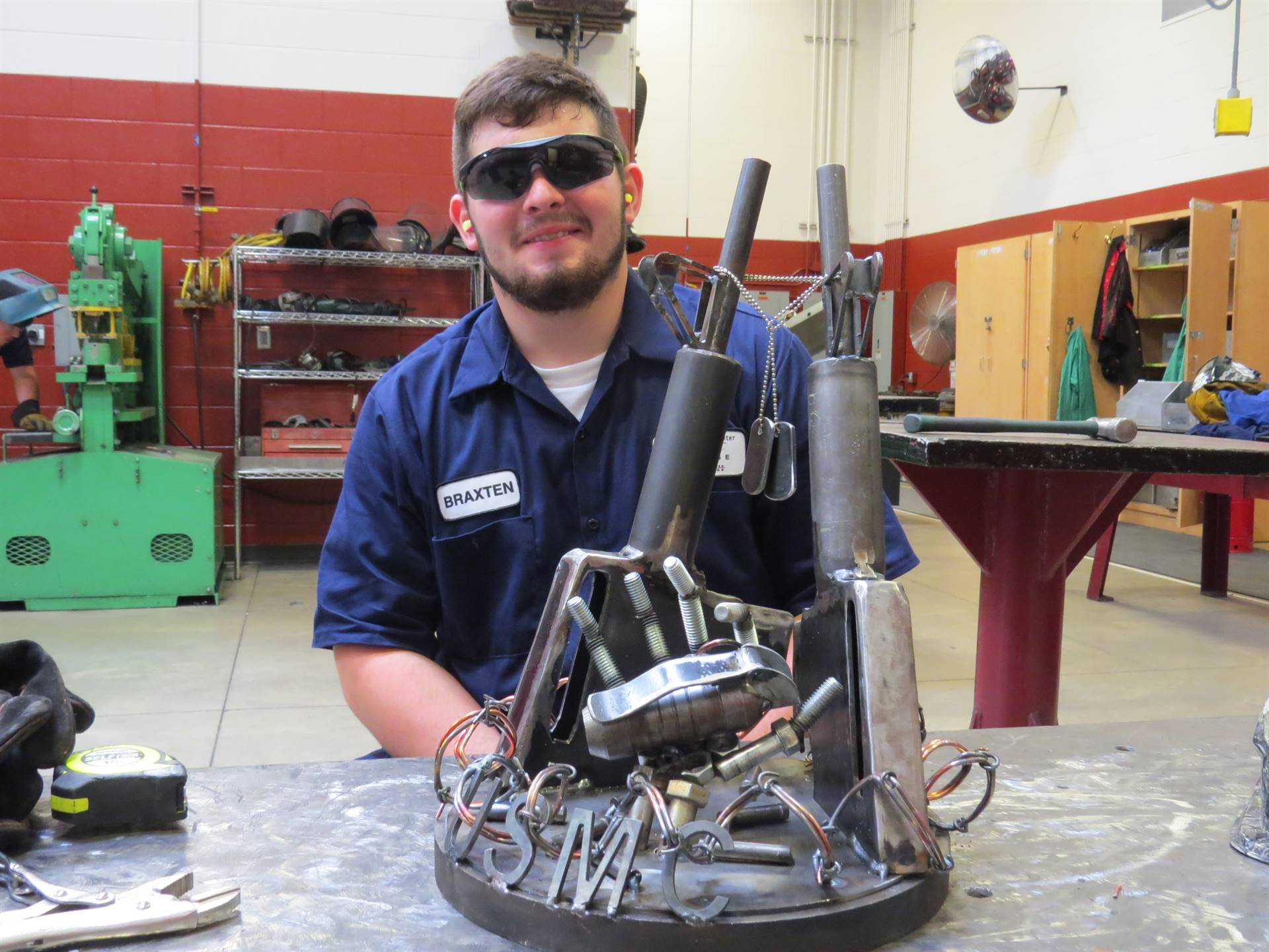 Male student with USMC welded statue