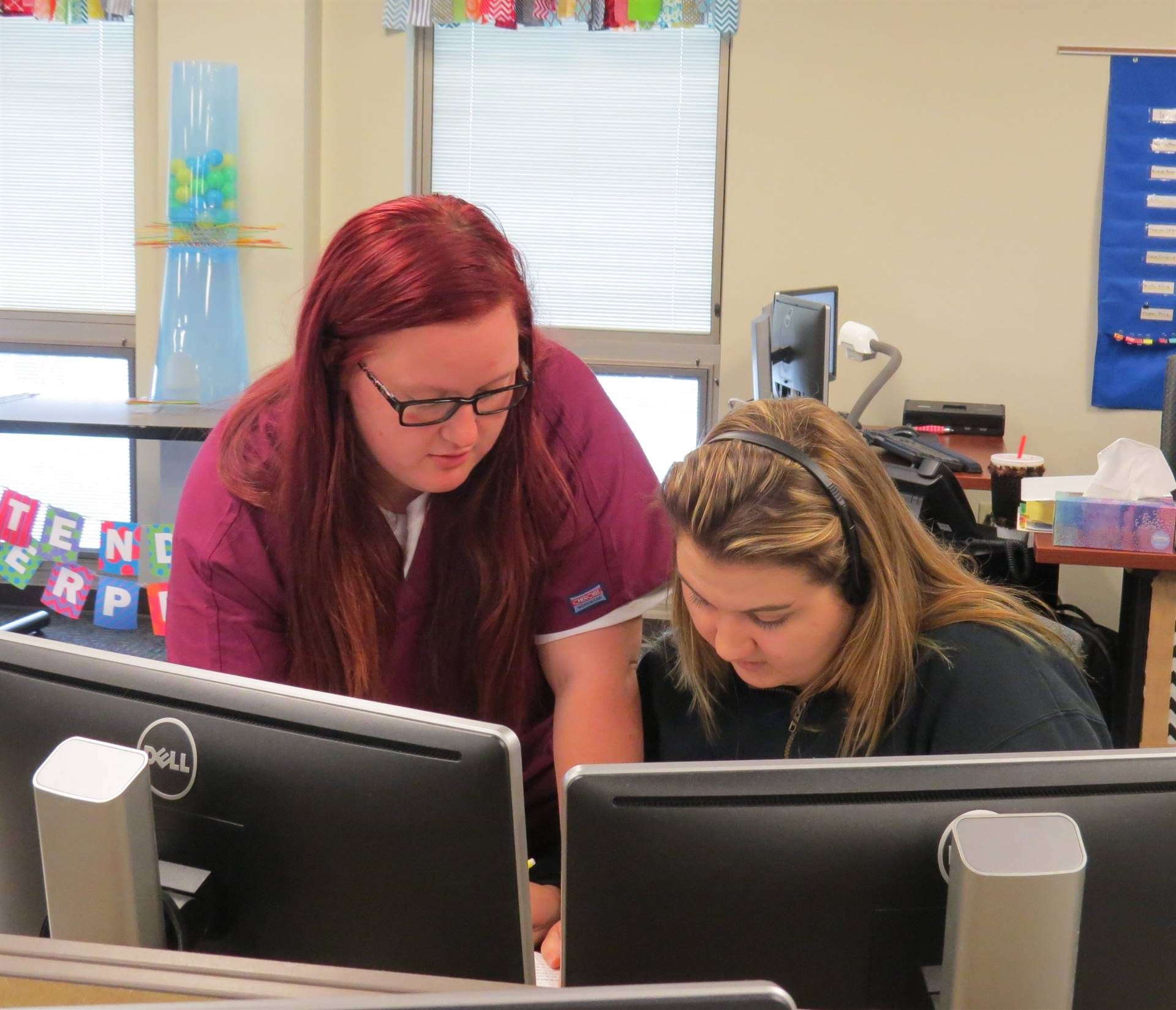 Two female students working together on the computer