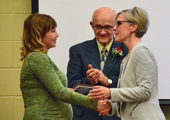 Kent Taylor's daughter, Sarah Perrott, accepts Hall of Fame plaque from Supt. Staci Kaufman