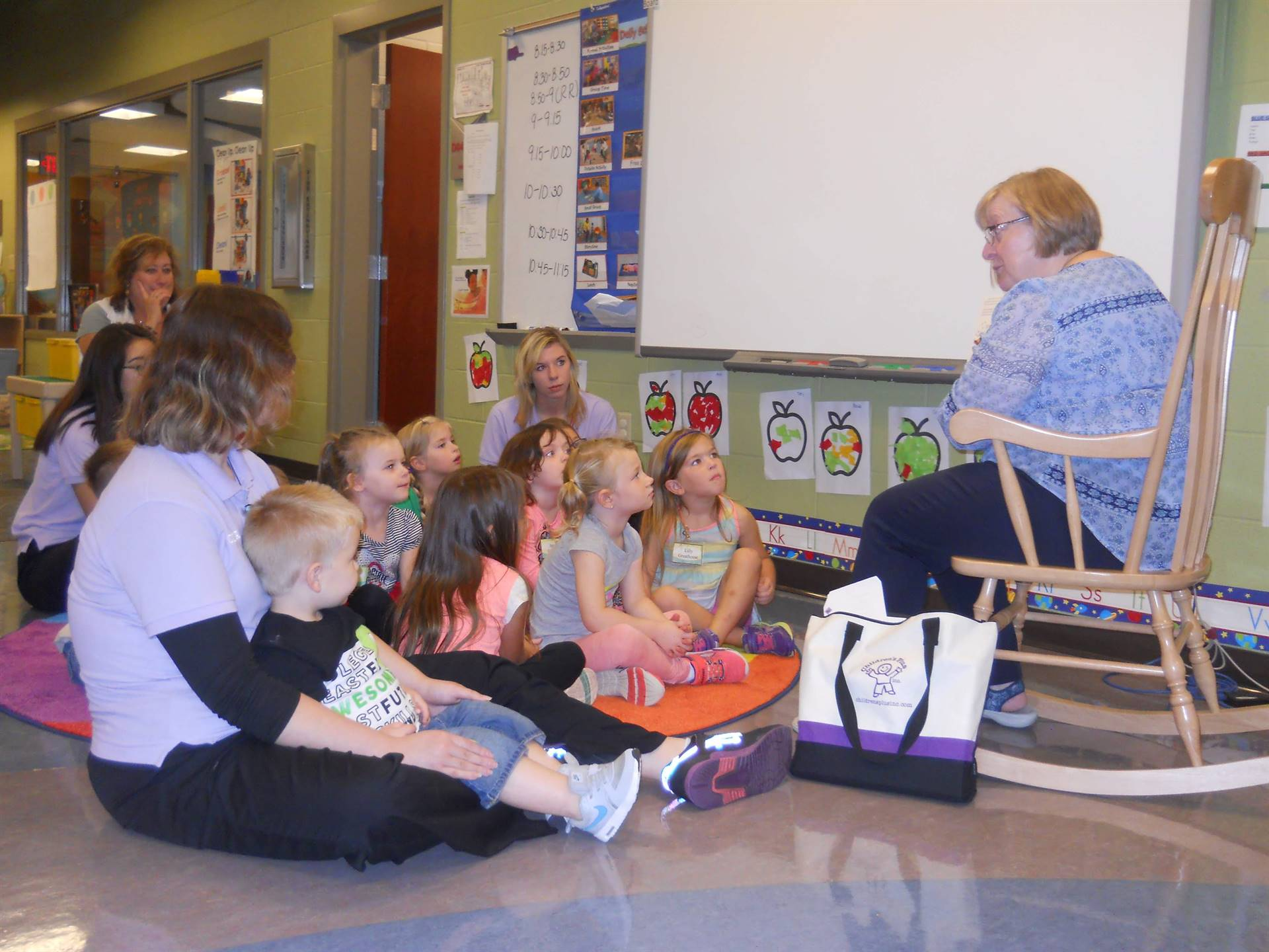 Brumback Librarian reads to preschool children.