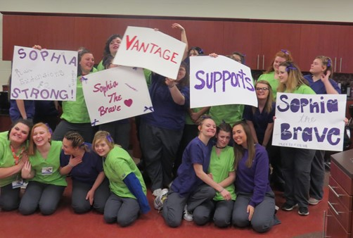 High school Cosmetology students holding signs supporting Sophia the Brave