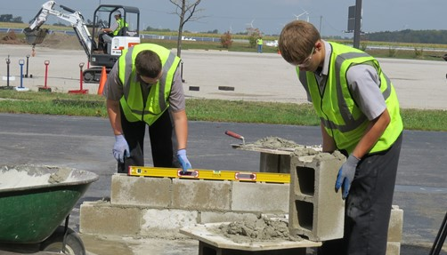 2 male students working on masonry
