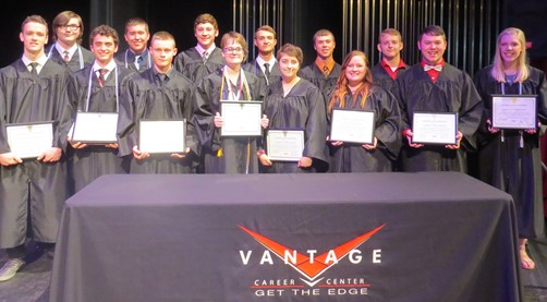 Award of Distinction high school students in black graduation gowns