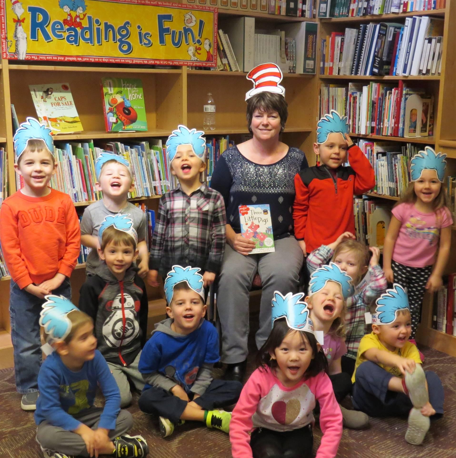 Preschoolers celebrating Read Across America with Mrs. Gillett
