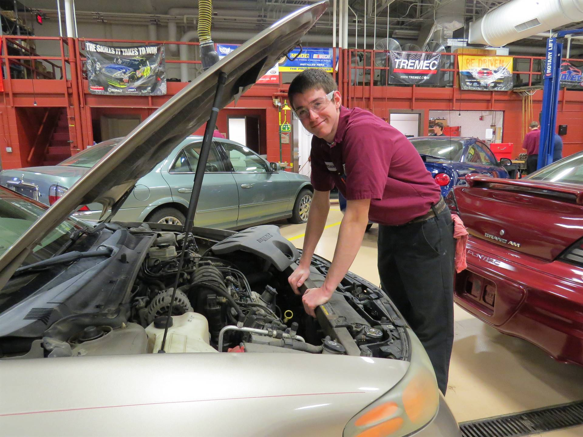 Auto Technology student is working on a vehicle.
