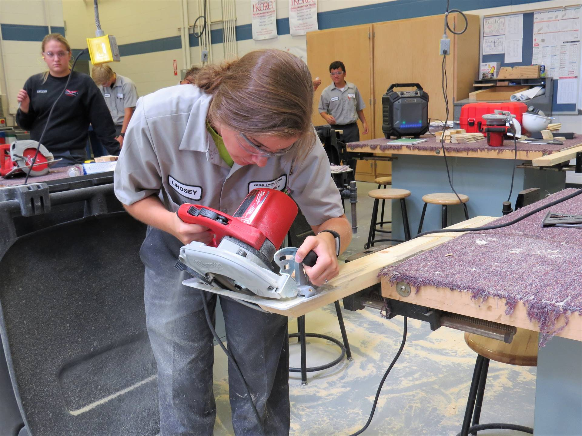 Carpentry students works on project.