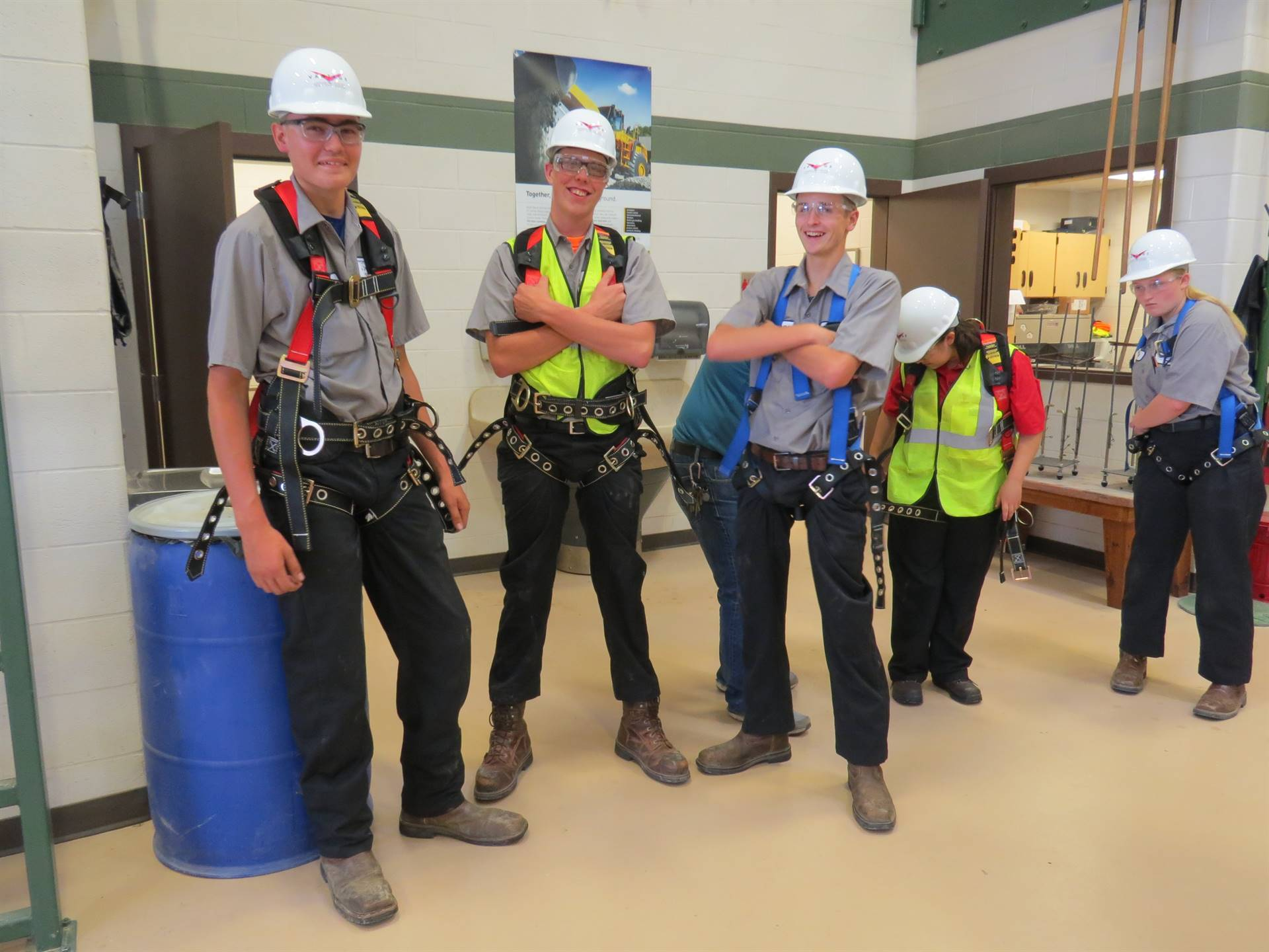 Construction Equipment Technology use safety harnesses during skills assessment.