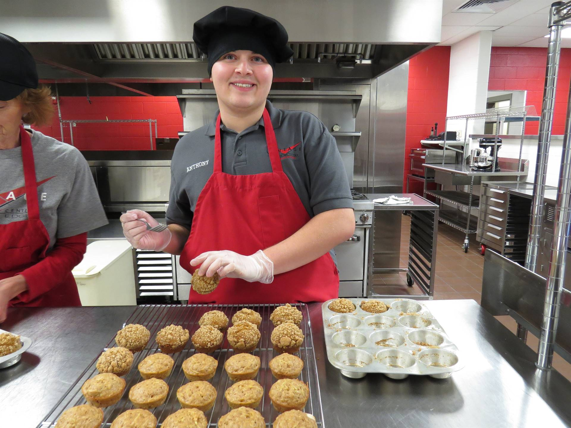 Culinary Arts student prepares muffins for a banquet.