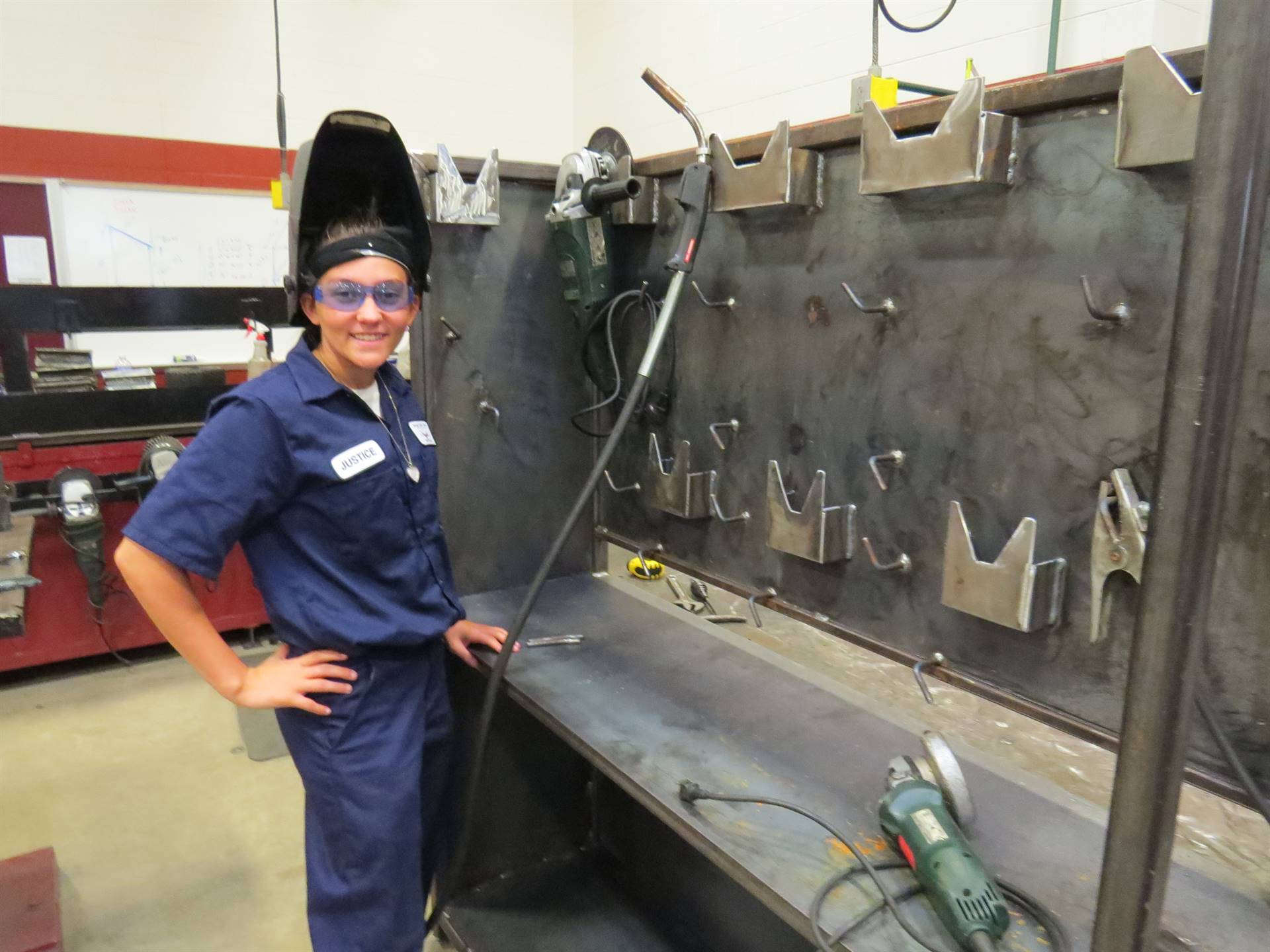 Welding student creates a design to be used for storage in the lab.