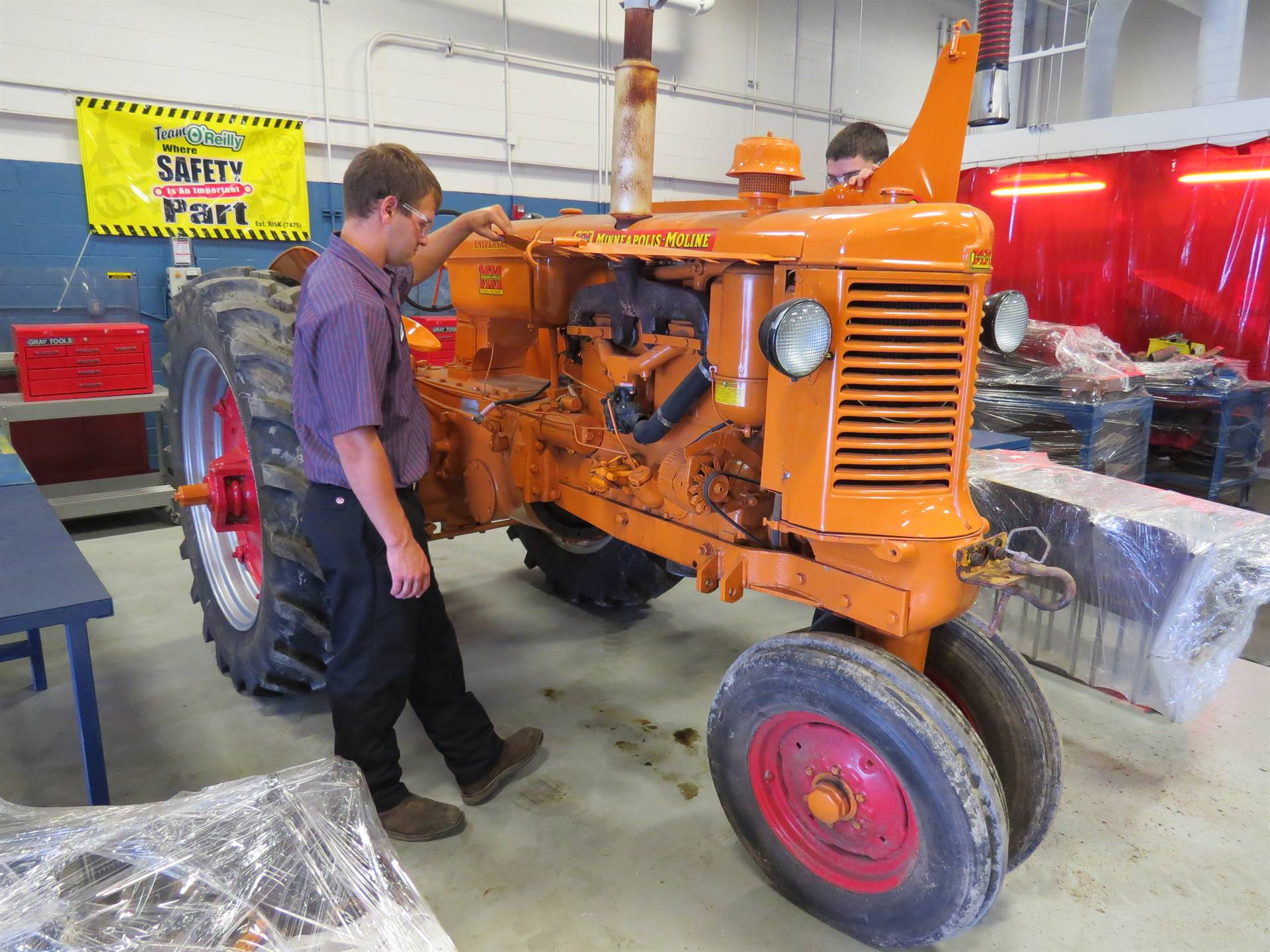 Ag & Industrial Power Technology student works on a tractor.
