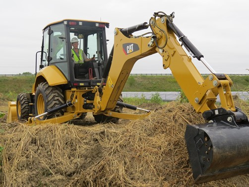 Construction Equipment Technology students operate a backhoe.