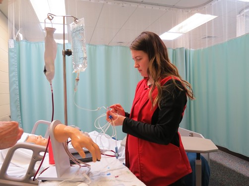 Practical Nursing Program student prepares for skills exam.
