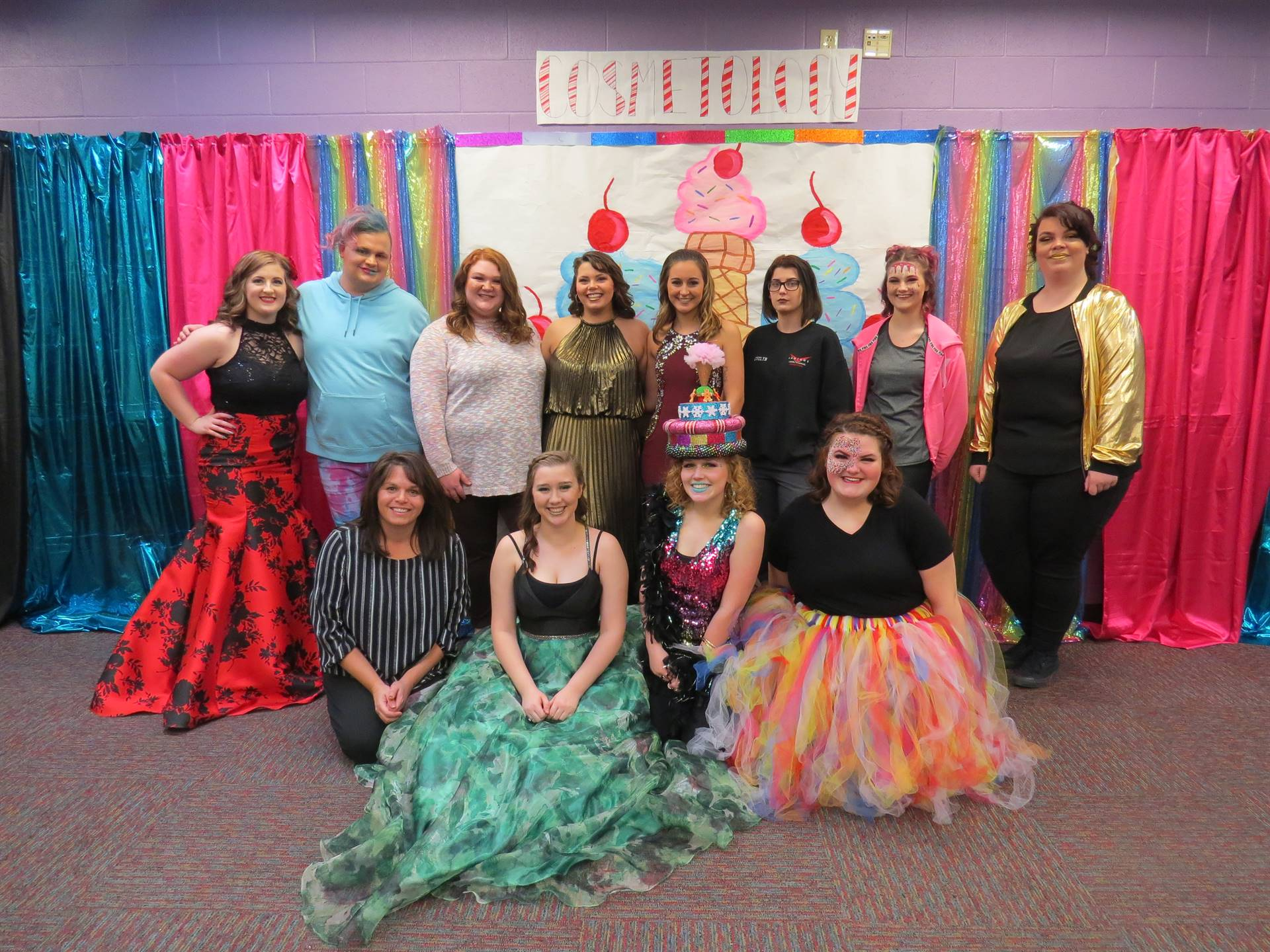 Cosmetology students pose after a fashion show.
