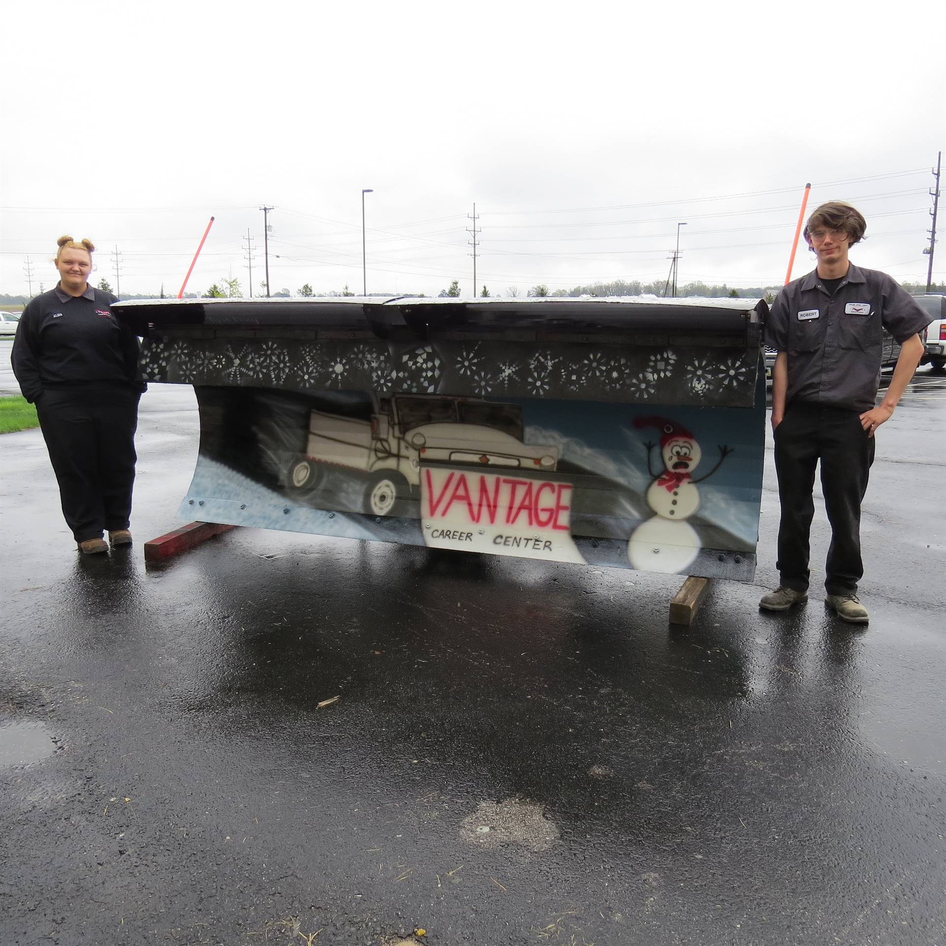 Auto Body Repair students create design for Paint The Plow contest.