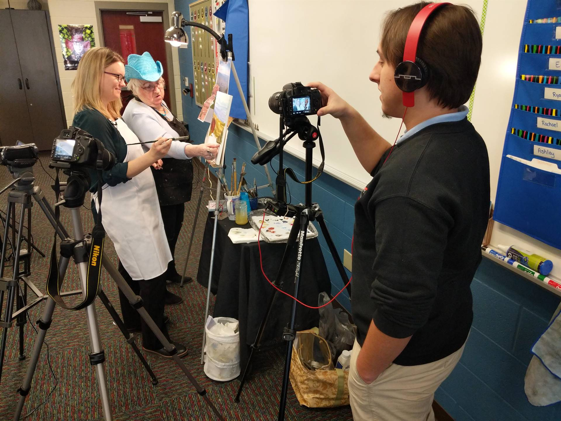 Interactive Media student videos a painter for production services.