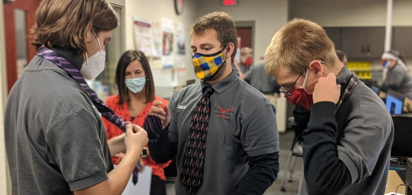network systems students practicing tying a neck tie